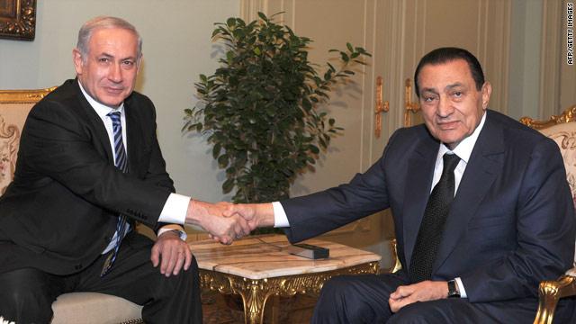 Israeli Prime Minister Benjamin Netanyahu, left, shakes hands wiith Egyptian President Hosni Mubarak.