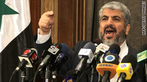 Khaled Meshaal gestures as he gives a speech in Damascus on June 28, 2010.