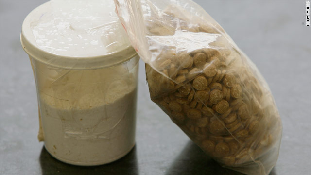 Captagon pills and a cup of cocaine displayed by Lebanese anti-narcotics forces in June 2010.