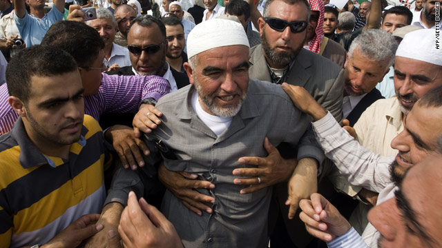 Sheikh Raed Salah is surrounded by supporters as he arrives at prison near Tel Aviv, Israel, on Sunday.
