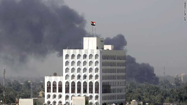 Smoke billows after a suicide car bomb targeted Al-Arabiya TV's office in central Baghdad on Monday.