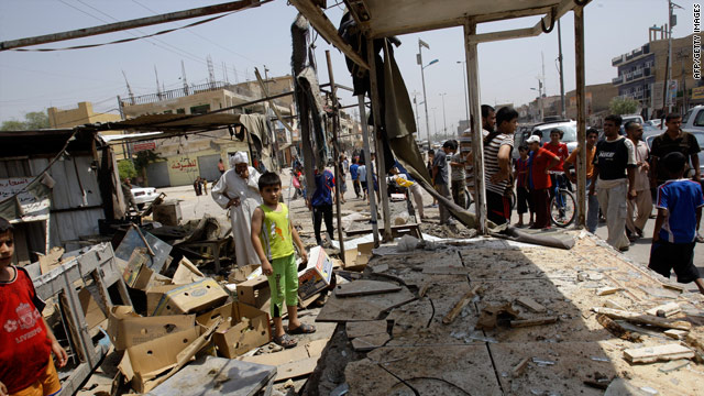 Iraqis look over the rubble of a restaurant where five people died in a bomb attack Thursday in Baghdad's Sadr City.