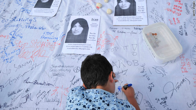 A boy signs a petition calling for an end to stoning during a protest in London on July, 24, 2010, to demand the release of Sakineh Mohammadi Ashtiani.