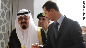 Saudi Arabia's King Abdulla, left, and Syria's President Bashar Assad chat after arriving in Beirut, Lebanon.