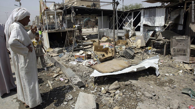 Iraqis look at the debris from a bomb that killed five people inside a restaurant in a Shiite area of Baghdad on July 28.