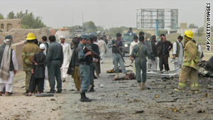Afghan first responders gather at the scene of a suicide bombing Monday in Kandahar.