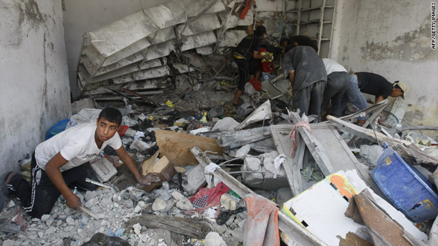 A boy inspects damage caused by an explosion in Gaza early on Monday.