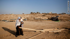 Nomads have been targets recently in the Sinai desert. A mother collected wood last week from her ruined home.