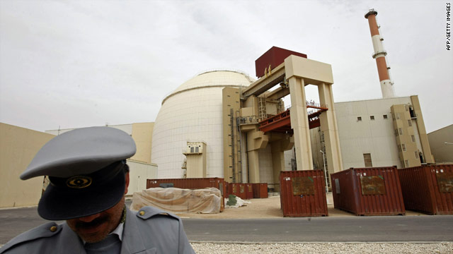 A file photo dated February 25, 2009, of an Iranian security guard outside the  Bushehr nuclear power plant.