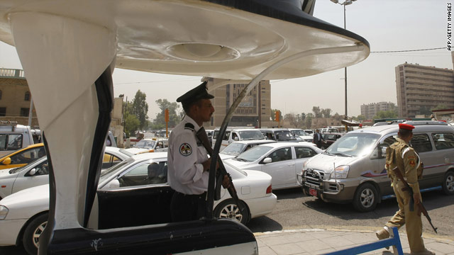 A police officer on duty in central Baghdad following a spate of shootings targeting police and civilians on August 15, 2010.