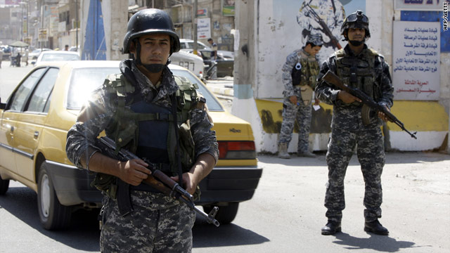 Iraqi soldiers on patrol in Baghdad on Thursday: The electoral commission worker was found shot dead in his car on Friday.