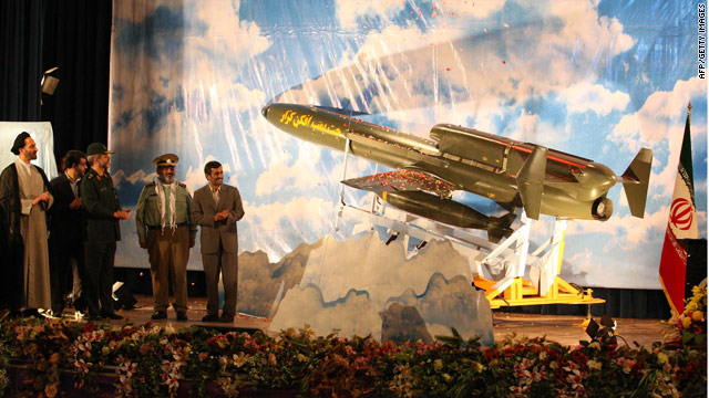 "An Iranian Defense Ministry photo shows President Ahmadinejad and the long-range drone dubbed ""Karrar"" on August 22, 2010."