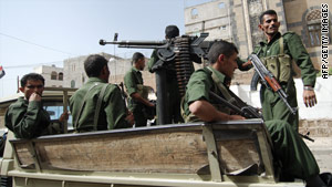 Security officers patrol a street in Sanaa, Yemen.