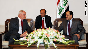 James Jeffrey, left, the new U.S. ambassador to Iraq, talks to Iraqi Prime Minister Nuri al-Maliki, right, via an interpreter.