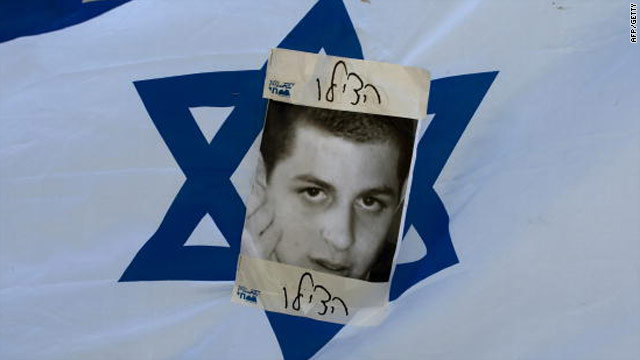 "An Israeli flag picturing abducted Israeli soldier Gilad Shalit and the word ""help,"" seen during a march in Jerusalem on July 8."