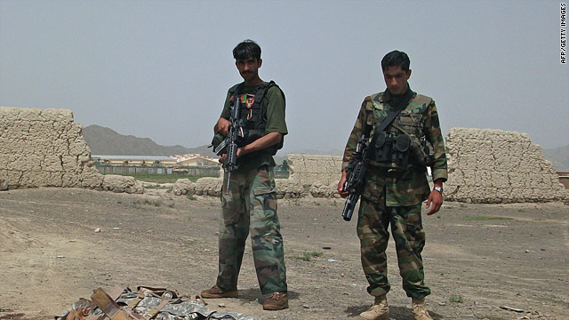 Afghan National Army soldiers stand guard near the body of a suicide attacker in Khost province on August 28.