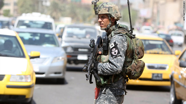 An Iraqi soldier monitors traffic in central Baghdad on Tuesday, the official end of the U.S. combat mission in Iraq.