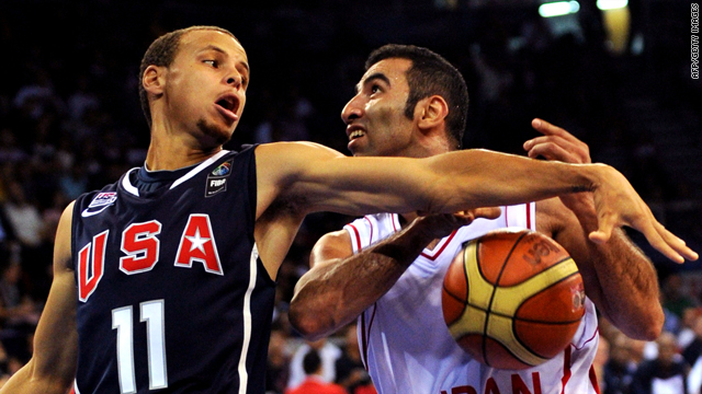 Stephen Curry swats the ball from the hands of Iran's Mahdi Makrany during the Group B game between the U.S. and Iran.