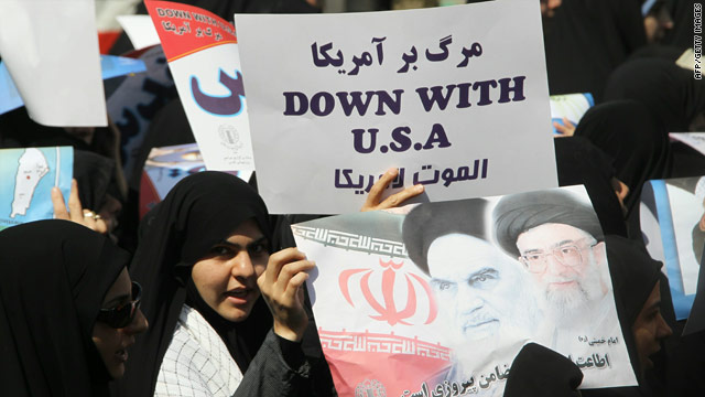 Iranian protesters hold anti-Israel and anti-US placards during the Jerusalem Day march in Tehran on September 3, 2010.