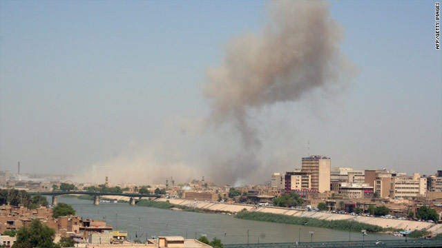 Smoke rises over an Iraqi military base hit by suicide bombers on Sunday in Baghdad.