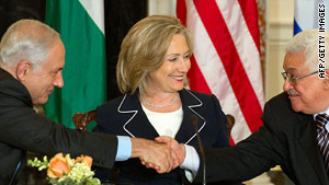 Israeli Prime Minister Benjamin Netanyahu (L) with Mahmoud Abbas on September 2.