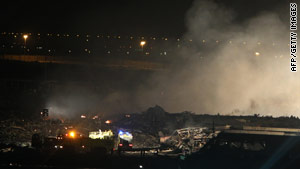 Smoke rises from the site where a plane crashed Friday near Dubai International Airport. Two UPS pilots were killed.
