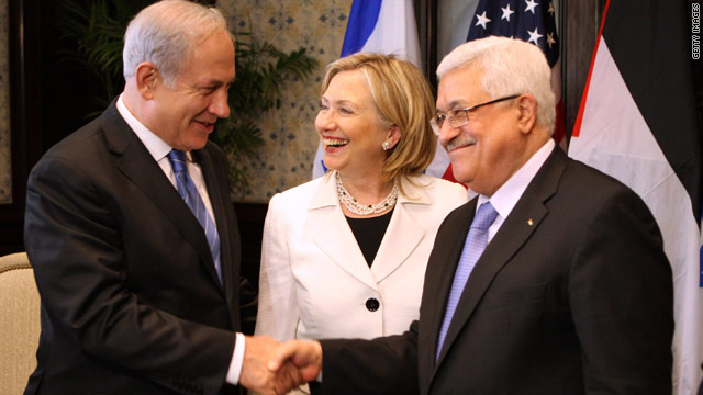 Israeli Prime Minister Benjamin Netanyahu, left, and Palestinian leader Mahmoud Abbas shake hands Tuesday as U.S. Secretary of State Hillary Clinton looks on.