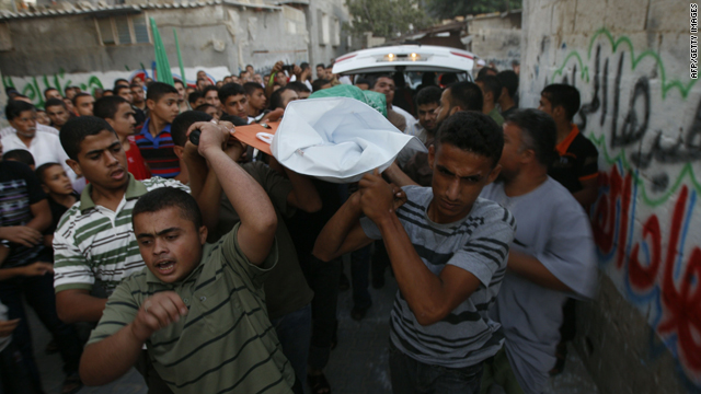 Palestinian mourners carry the body of Wajdi al-kadi, who was killed in an Israeli airstrike on tunnels near Rafah Wednesday.