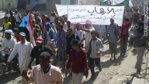 "Yemenis marched this week, hoisting a banner which read: ""We condemn terrorism in all its forms all over the world."""