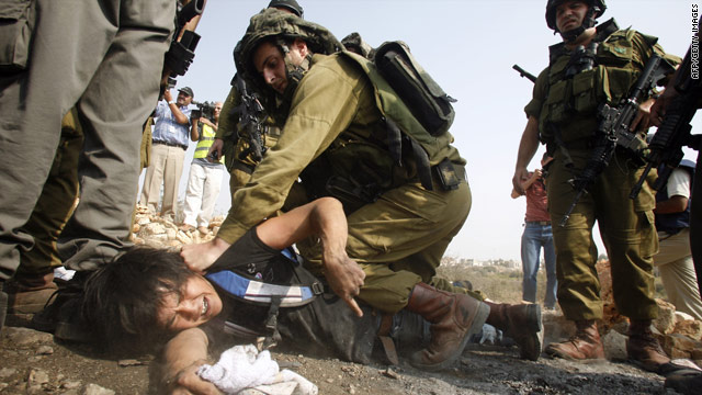 Israeli soldiers clash with Palestinian and Israeli demonstrators at a protest against Jewish settlements in the West Bank village of Beit Omar on Saturday.