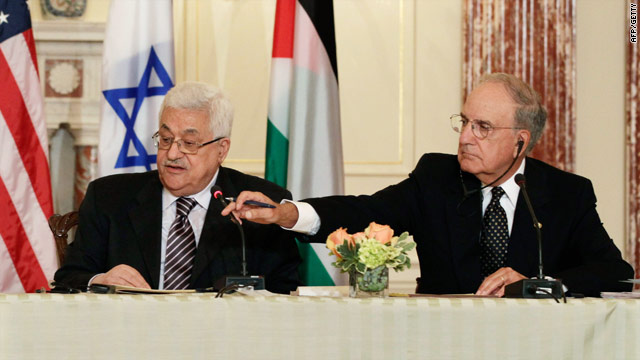 U.S. special Mideast envoy George Mitchell (R) -- pictured here with President Mahmoud Abbas -- will arrive in Israel Tuesday.