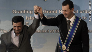 Syrian President Bashar al-Assad (right) met Iranian counterpart Mahmoud Ahmadinejad in Tehran.
