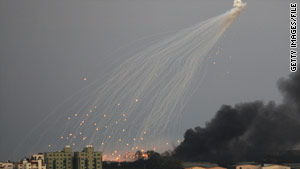 Israeli artillery shells rain down on Gaza buildings in January 2009 during a three-week offensive.
