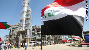 The Iraqi flag flutters during the opening of the Al-Dora refinery complex in Baghdad last month.