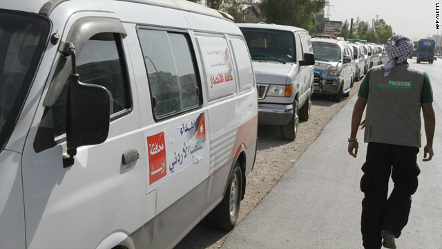 Vehicles in Damascus on October 4, 2010, wait to join other aid convoys making their way to the Syrian port of Lattakia.