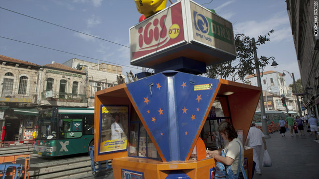 A woman buys a lottery ticket from a special kiosk in central Jerusalem on Sunday.