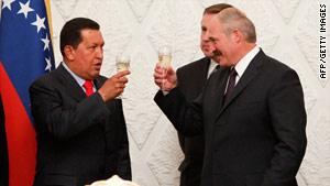 Venezuelan President Hugo Chavez, left, shares a toast with Belarusian President Alexander Lukashenko.