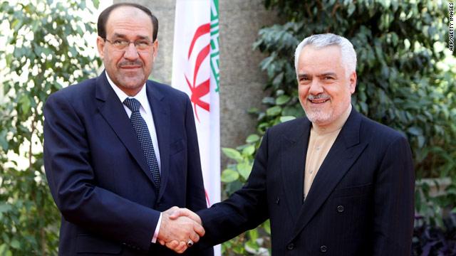 Iran's First Vice President Mohammad Reza Rahimi (right) greets Iraqi PM Nuri al-Maliki in Tehran on Monday.