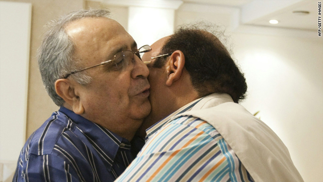 Iranian-American businessman Reza Taghavi, right, greets a friend at his home in Tehran on Sunday a day after being freed.