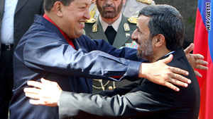 Venezuelan President Hugo Chavez and his Iranian counterpart Mahmoud Ahmadinejad greet each in Tehran.