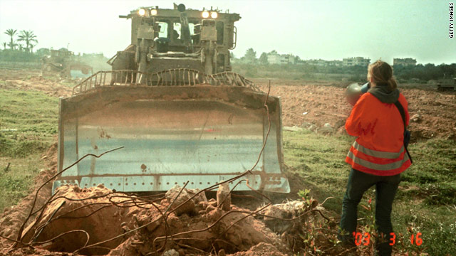 American peace activist Rachel Corrie, 23, tries to stop an Israeli bulldozer from destroying Palestinian land March 16, 2003.