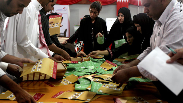 Members of the Bahraini voting committee start counting the ballots at voting station in Isa city on October 23.