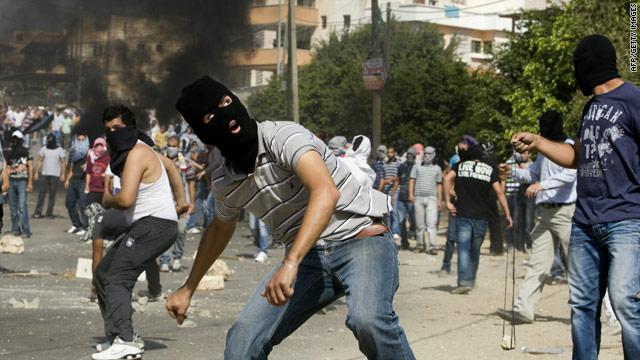 Arab-Israelis and Israeli riot police clash in Umm Al-Fahm, on October 27, 2010.