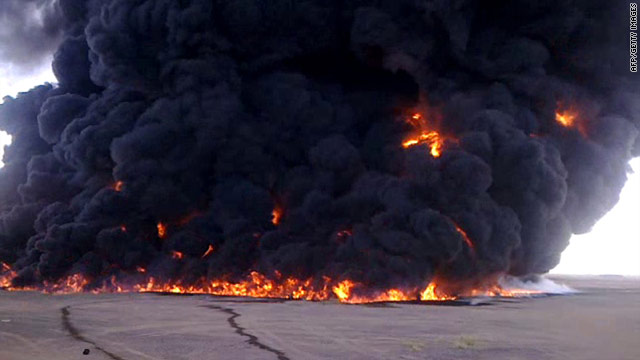 Smoke billows from a burning oil pipeline struck by an explosion Tuesday in southern Yemen.