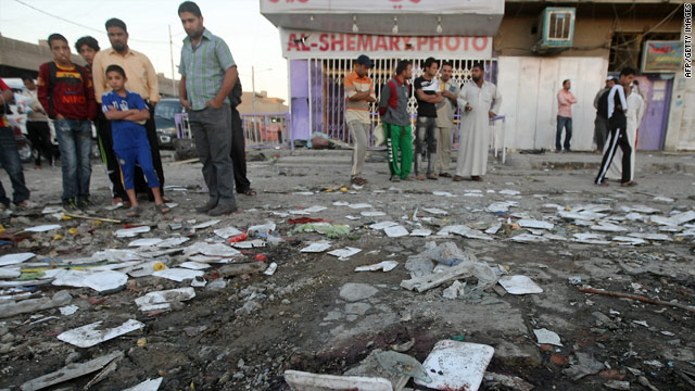 Iraqis inspect damage at a market on November 3, 2010, one day after a blast in the Sadr City district of Baghdad.