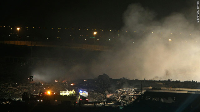 An image dated September 3, 2010 shows smoke rising from the crash scene of a UPS cargo plane at a military base in Dubai.
