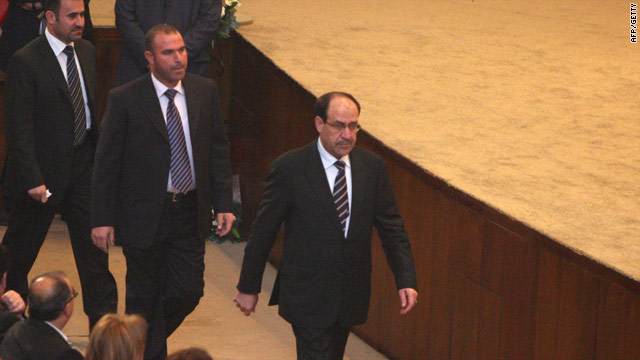 PM Nuri al-Maliki walks past lawmakers in Baghdad on Thursday -- leaders Friday were trying to salvage the power-sharing deal.