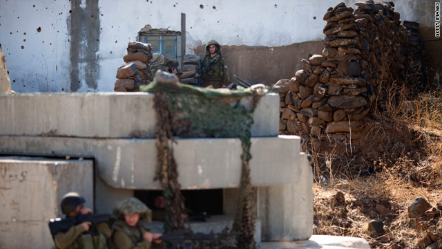 Israeli soldiers take their positions in the village of Ghajar on November 10, 2010.