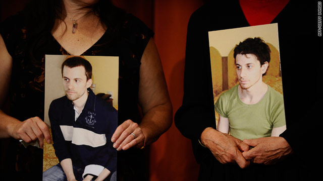 The mothers of Shane Bauer, shown left, and Josh Fattal hold pictures of the two hikers being held in Iran.