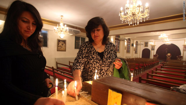 Iraqi Christians light candles at a church in Amman on November 21 after they fled their country.